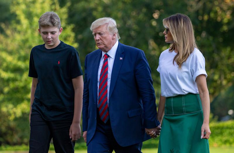 Barron Trump is taller than his mom, even in her heels, and he's sporting a new haircut