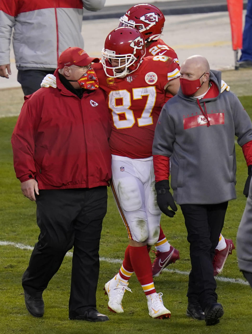 FILE - In this Jan. 17, 2021, file photo, Kansas City Chiefs tight end Travis Kelce (87) walks off the field with coach Andy Reid after an NFL divisional round football game against the Cleveland Browns in Kansas City, Mo. Both Reid and Bruce Arians are considered players coaches, though they do it in different ways. It's a quality thats helped them reach the Super Bowl. (AP Photo/Orlin Wagner, File)