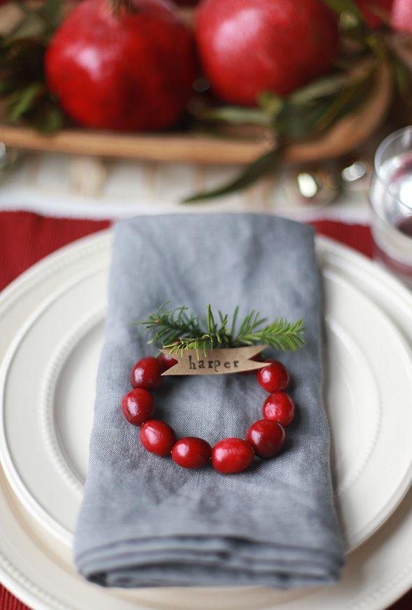 """<p>How adorable are these? They're easy to make—just string cranberries onto a piece of wire, twist the wire around, add pieces of tree trimmings, and attach flag-shaped kraft paper tags onto each one. </p><p><strong>Get the tutorial at <a href=""""https://sayyes.com/2014/12/diy-mini-cranberry-wreath-place-cards"""" rel=""""nofollow noopener"""" target=""""_blank"""" data-ylk=""""slk:Say Yes"""" class=""""link rapid-noclick-resp"""">Say Yes</a>.</strong></p><p><strong><a class=""""link rapid-noclick-resp"""" href=""""https://www.amazon.com/Cloth-Napkins-Blue-Kitchen-Table-Linens/?tag=syn-yahoo-20&ascsubtag=%5Bartid%7C10050.g.644%5Bsrc%7Cyahoo-us"""" rel=""""nofollow noopener"""" target=""""_blank"""" data-ylk=""""slk:SHOP NAPKINS"""">SHOP NAPKINS</a></strong></p>"""