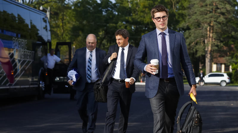 LUCAN, ON - SEPTEMBER 18: General manager Kyle Dubas of the Toronto Maple Leafs makes his way into the arena from the team bus prior to their preseason game against the Ottawa Senators during Kraft Hockeyville Canada at the Lucan Community Memorial Centre on September 18, 2018 in Lucan, Ontario, Canada. (Photo by Mark Blinch/NHLI via Getty Images)