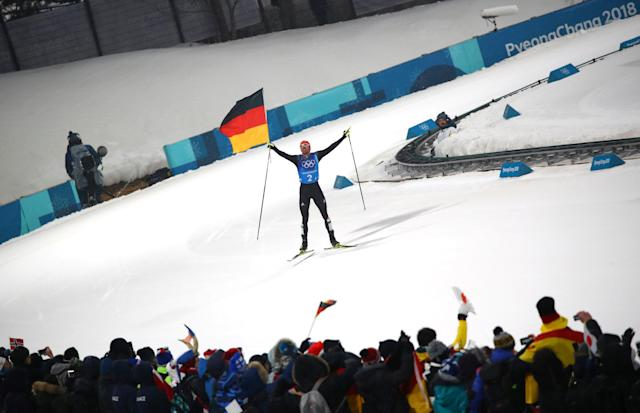 Nordic Combined Events - Pyeongchang 2018 Winter Olympics - Men's Team 4 x 5 km Final - Alpensia Cross-Country Skiing Centre - Pyeongchang, South Korea - February 22, 2018 - Johannes Rydzek of Germany waves the German flag as he approaches the finish line. REUTERS/Carlos Barria TPX IMAGES OF THE DAY