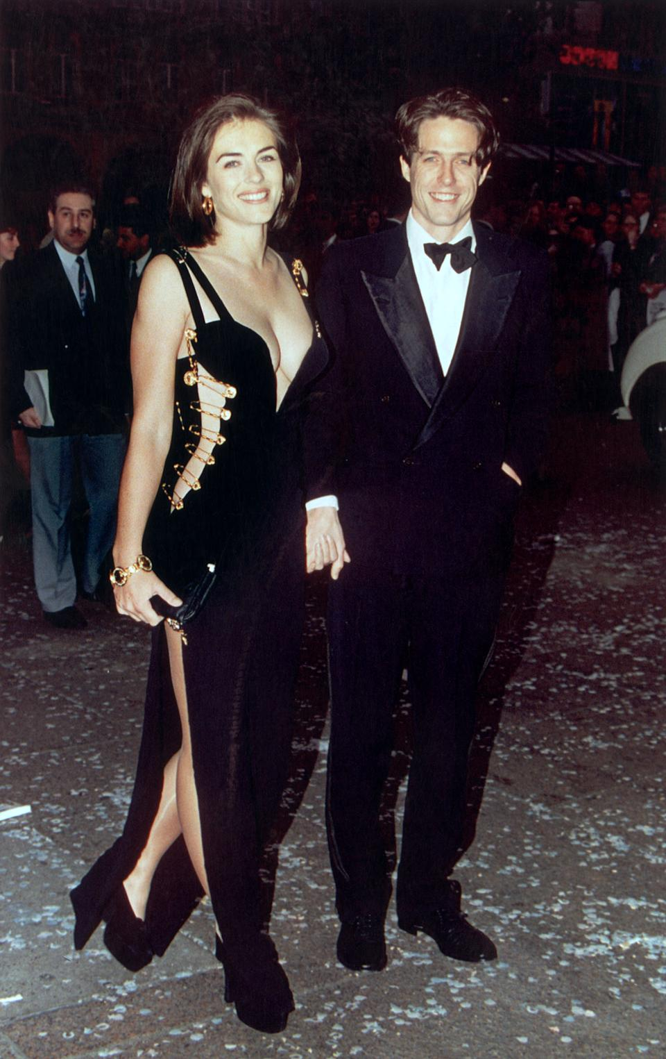 British actor Hugh Grant and his girlfriend Elizabeth Hurley attend the premiere of Grant's latest film, 'Four Weddings and a Funeral' in London, 11th May 1994. (Photo by Gareth Davies/Mission Pictures/Getty Images) *** North American Sales Only ***
