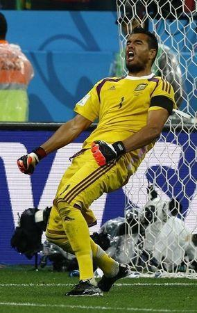 Argentina's goalkeeper Sergio Romero celebrates saving the match deciding penalty in their 2014 World Cup semi-finals against Netherlands at the Corinthians arena in Sao Paulo July 9, 2014. REUTERS/Darren Staples