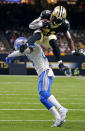 <p>New Orleans Saints running back Alvin Kamara (41) leaps over Detroit Lions cornerback Darius Slay in the second half of an NFL football game in New Orleans, Sunday, Oct. 15, 2017. (AP Photo/Butch Dill) </p>