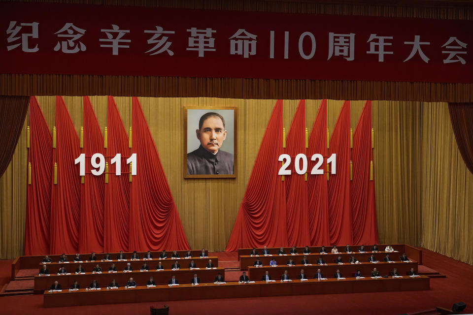 Chinese President Xi Jinping, center, delivers a speech at an event commemorating the 110th anniversary of Xinhai Revolution at the Great Hall of the People in Beijing, Saturday, Oct. 9, 2021. (AP Photo/Andy Wong)