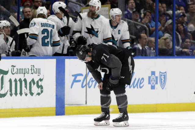 Tampa Bay Lightning center Anthony Cirelli (71) is doubled over after taking a stick to the face during the second period of an NHL hockey game against the San Jose Sharks Saturday, Dec. 7, 2019, in Tampa, Fla. (AP Photo/Chris O'Meara)