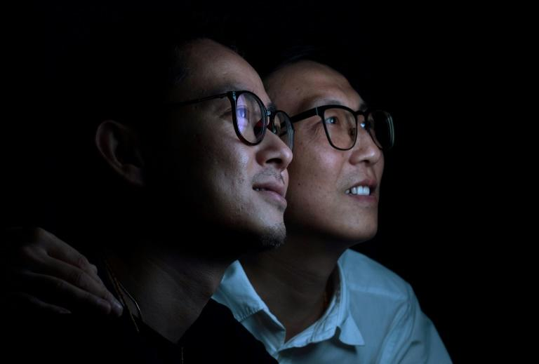 Li Tao (L) and Duan Rongfeng are among a new generation of gay Chinese willing to take a stand on their sexuality, despite family pressure to conform