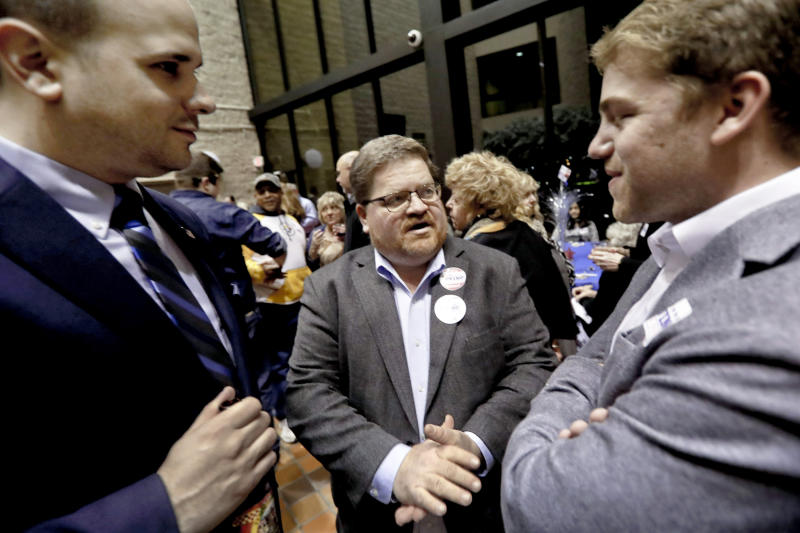 CORRECTS SPELLING OF LAST NAME TO WESSELL INSTEAD OF WESSEL - In this Tuesday, April 2, 2019, photo Mike Wessell, center, a Republican-turned Democrat, talks with other supporters for democratic party candidate for Pennsylvania state senator Pam Iovino at her election returns party in Pittsburgh. Some Democrats thought they didn't need white male voters in 2016. But the party knows it needs them in 2020. (AP Photo/Keith Srakocic)