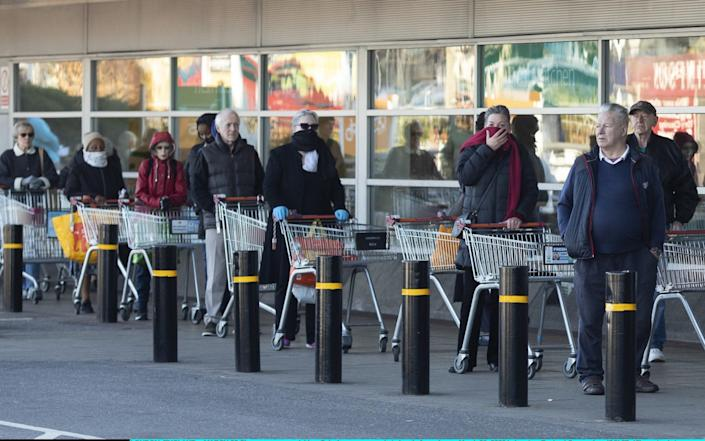 Sainsbury's wants to reduce the number of people queuing outside its supermarkets - Getty