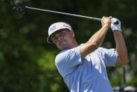 Keith Mitchell tees off on the seventh hole during the fourth round of the Wells Fargo Championship golf tournament at Quail Hollow on Sunday, May 9, 2021, in Charlotte, N.C. (AP Photo/Jacob Kupferman)