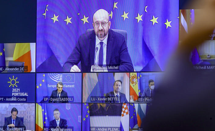 European Council President Charles Michel, top of screen, takes part in an EU Summit, via videoconference link, at the European Council building in Brussels, Thursday, Feb. 25, 2021. European Union leaders are gathering Thursday, via videoconference link, to try to inject new energy into the 27-nation bloc's lagging coronavirus vaccination effort as concern mounts that new variants might spread faster than authorities can adapt. (Olivier Hoslet, Pool via AP)