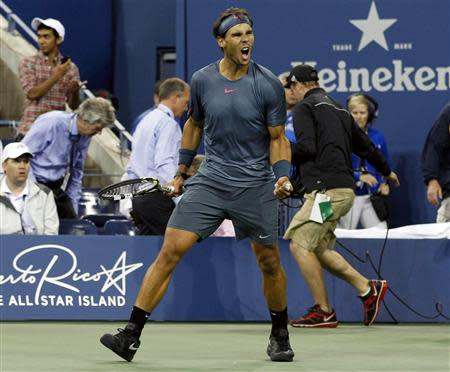 Rafael Nadal of Spain celebrates defeating compatriot Tommy Robredo during their men's quarter-final matchat the U.S. Open tennis championships in New York September 4, 2013. REUTERS/Adam Hunger