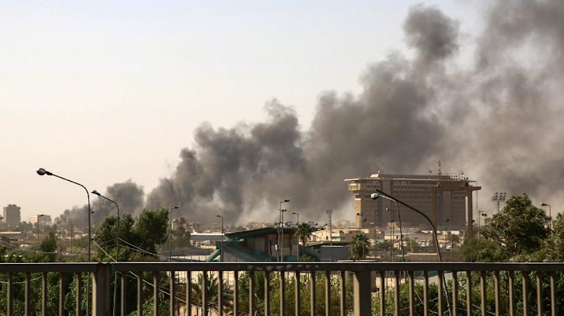 Smoke billows across the skyline of Baghdad as a fire rages through the country's biggest ballot warehouse where votes from May elections are stored until a recount (AFP Photo/SABAH ARAR)