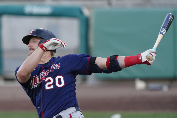 Minnesota Twins' Josh Donaldson follows through on a two-run home run in the second inning of a spring training baseball game against the Boston Red Sox, Thursday, March 25, 2021, in Fort Myers, Fla. (AP Photo/John Bazemore)