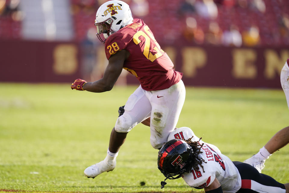 Iowa State running back Breece Hall (28) breaks a tackle by Texas Tech defensive back Thomas Leggett (16) during the second half of an NCAA college football game, Saturday, Oct. 10, 2020, in Ames, Iowa. Iowa State won 31-15. (AP Photo/Charlie Neibergall)