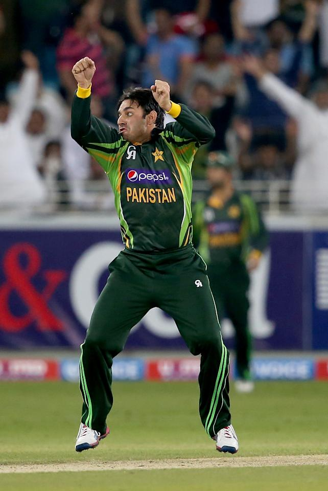 DUBAI, UNITED ARAB EMIRATES - DECEMBER 13:  Saeed Ajmal of Pakistan celebrates during the second Twenty20 International match between Pakistan and Sri Lanka at Dubai Sports City Cricket Stadium on December 13, 2013 in Dubai, United Arab Emirates.  (Photo by Francois Nel/Getty Images)