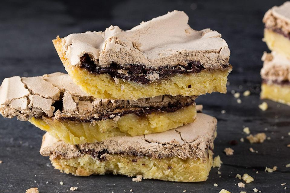 """Filled with bittersweet chocolate and topped with brown sugar meringue, these bars may disappear from your kitchen a bit faster than you expected. <a href=""""https://www.epicurious.com/recipes/food/views/dream-bars-56389459?mbid=synd_yahoo_rss"""" rel=""""nofollow noopener"""" target=""""_blank"""" data-ylk=""""slk:See recipe."""" class=""""link rapid-noclick-resp"""">See recipe.</a>"""