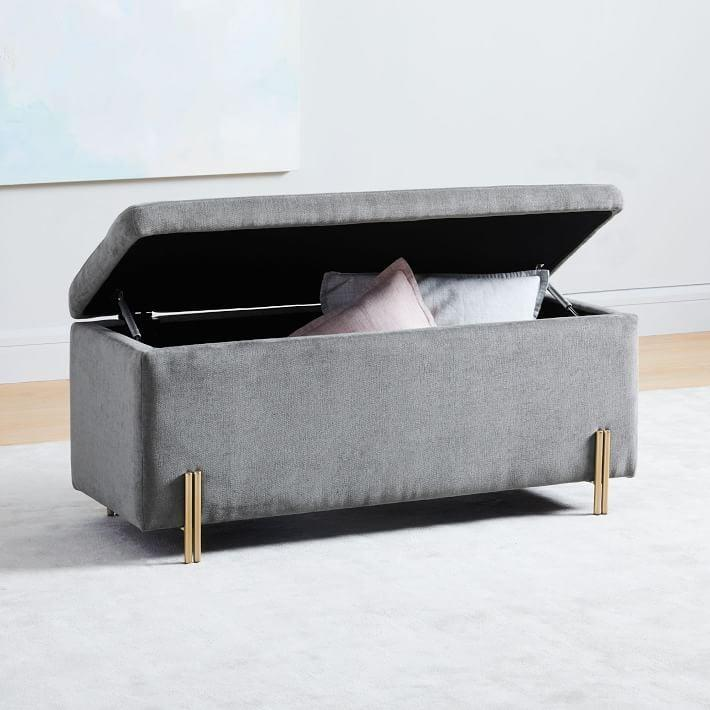 <p>We adore the gold legs on this chic <span>West Elm Mod Storage Bench</span> ($499-$749).</p>