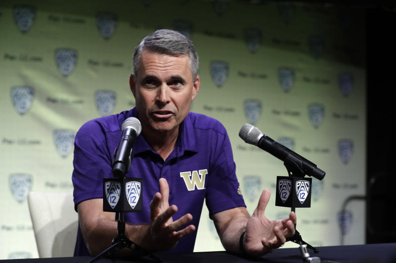 Washington head coach Chris Petersen answers questions during the Pac-12 Conference NCAA college football Media Day Wednesday, July 24, 2019, in Los Angeles. (AP Photo/Marcio Jose Sanchez)