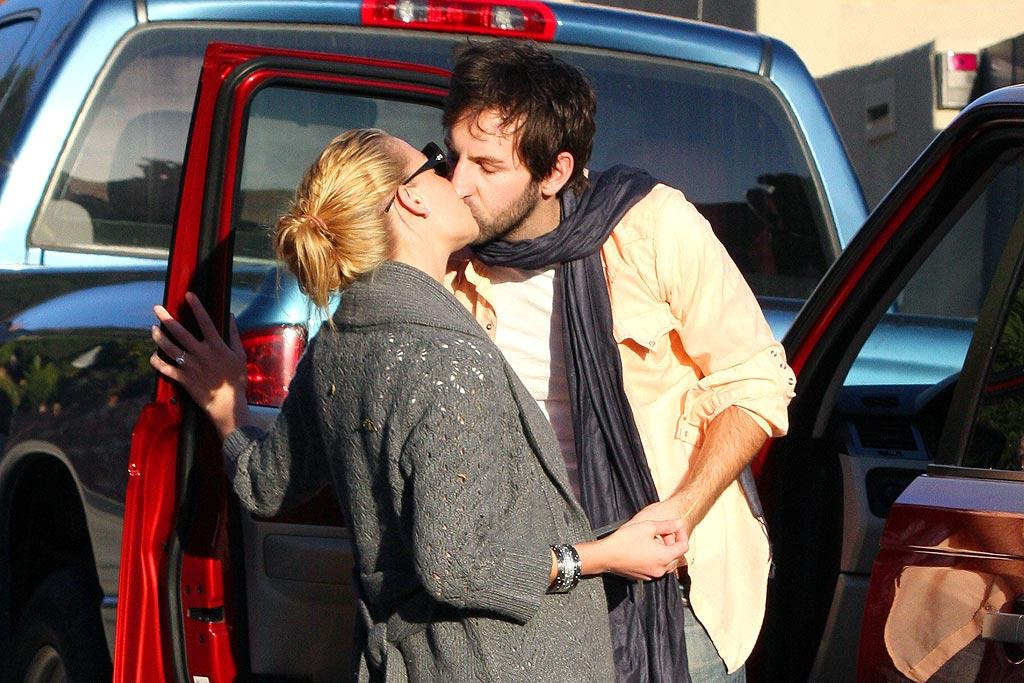 "Katherine Heigl braces herself for an incoming kiss from husband Josh Kelley. Ginsburg-Spaly/<a href=""http://www.x17online.com"" target=""new"">X17 Online</a> - December 1, 2007"