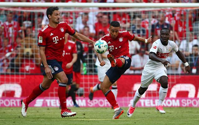 Soccer Football - Bundesliga - Bayern Munich v VfB Stuttgart - Allianz Arena, Munich, Germany - May 12, 2018 Bayern Munich's Thiago Alcantara and Mats Hummels in action with Stuttgart's Chadrac Akolo REUTERS/Michael Dalder DFL RULES TO LIMIT THE ONLINE USAGE DURING MATCH TIME TO 15 PICTURES PER GAME. IMAGE SEQUENCES TO SIMULATE VIDEO IS NOT ALLOWED AT ANY TIME. FOR FURTHER QUERIES PLEASE CONTACT DFL DIRECTLY AT + 49 69 650050