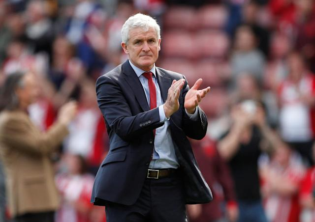 "Soccer Football - Premier League - Southampton vs Manchester City - St Mary's Stadium, Southampton, Britain - May 13, 2018 Southampton manager Mark Hughes applauds fans during a lap of appreciation after the match Action Images via Reuters/John Sibley EDITORIAL USE ONLY. No use with unauthorized audio, video, data, fixture lists, club/league logos or ""live"" services. Online in-match use limited to 75 images, no video emulation. No use in betting, games or single club/league/player publications. Please contact your account representative for further details."