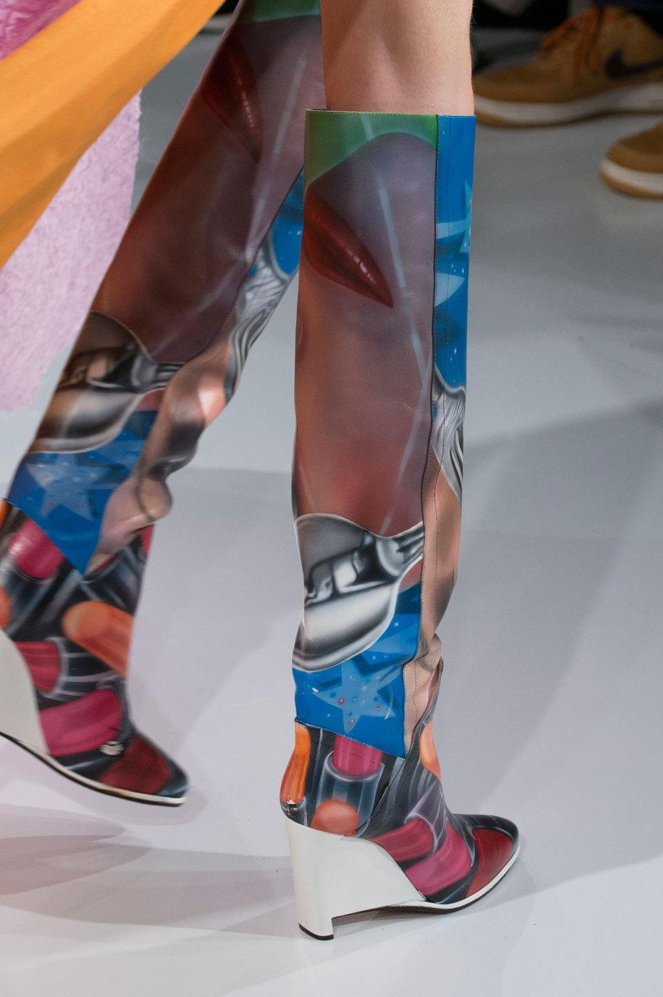 """<p>Who said airbrushed scenes were just for vans? At <a href=""""http://eboutique.maisonmargiela.com/"""" rel=""""nofollow noopener"""" target=""""_blank"""" data-ylk=""""slk:Maison Margiela"""" class=""""link rapid-noclick-resp"""">Maison Margiela</a>, John Galliano thinks these boots were made for tripping. <i>Photos: Imaxtree</i></p>"""