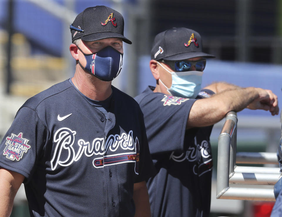 Atlanta Braves Hall of Fame third baseman Chipper Jones and manager Brian Snitker watch batting practice during spring baseball training Tuesday, Feb. 23, 2021, in North Port, Fla. (Curtis Compton/Atlanta Journal-Constitution via AP)