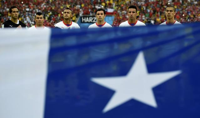 Chile's national soccer players sing the national anthem before their 2014 World Cup Group B soccer match against Spain in Rio de Janeiro