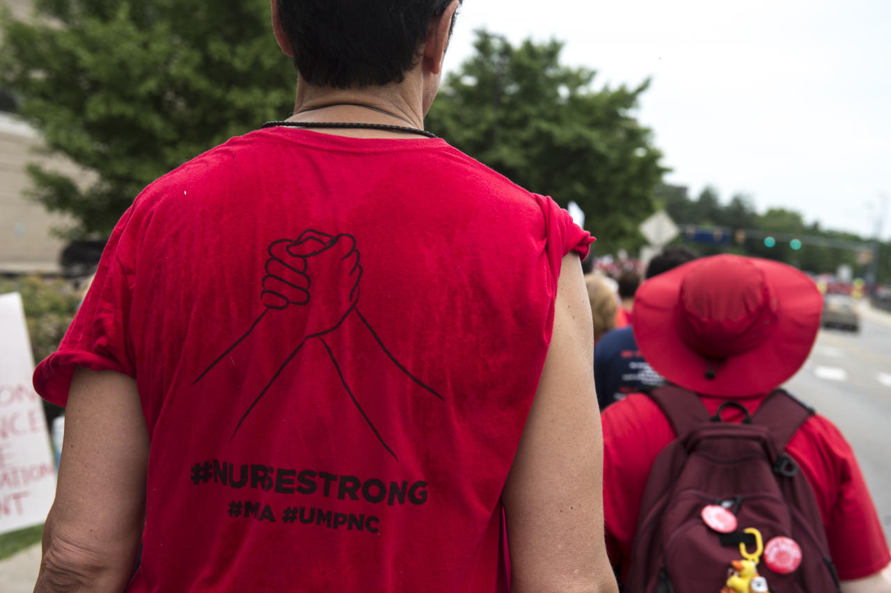 A shirt in support of the University of Michigan Professional Nurses Council at an informational picket and rally in Ann Arbor, Mich., Saturday, July 14, 2018. Participants in the rally continue their fight with Michigan Medicine over the contract which expired on June 30. The picket was held to protest contentious issues such as retirement cutbacks, increased health care costs and guaranteed staffing levels remain unresolved. (Ben Allan Smith/Ann Arbor News via AP)