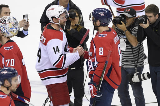 Carolina Hurricanes right wing Justin Williams (14) shakes hands with Washington Capitals left wing Alex Ovechkin (8), of Russia, after Game 7 of an NHL hockey first-round playoff series, Wednesday, April 24, 2019, in Washington. The Hurricanes won 4-3 in double overtime. (AP Photo/Nick Wass)