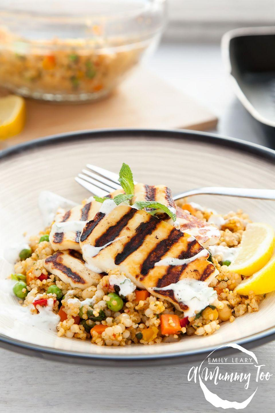 """<p>The yoghurt mint dressing simply makes this!</p><p>Get the <a href=""""https://www.amummytoo.co.uk/grilled-halloumi-vegetable-couscous-with-a-yoghurt-mint-dressing/"""" rel=""""nofollow noopener"""" target=""""_blank"""" data-ylk=""""slk:Grilled Halloumi Vegetable Couscous"""" class=""""link rapid-noclick-resp"""">Grilled Halloumi Vegetable Couscous</a> recipe. </p><p>Recipe from <a href=""""https://www.amummytoo.co.uk/"""" rel=""""nofollow noopener"""" target=""""_blank"""" data-ylk=""""slk:A Mummy Too"""" class=""""link rapid-noclick-resp"""">A Mummy Too</a>.</p>"""