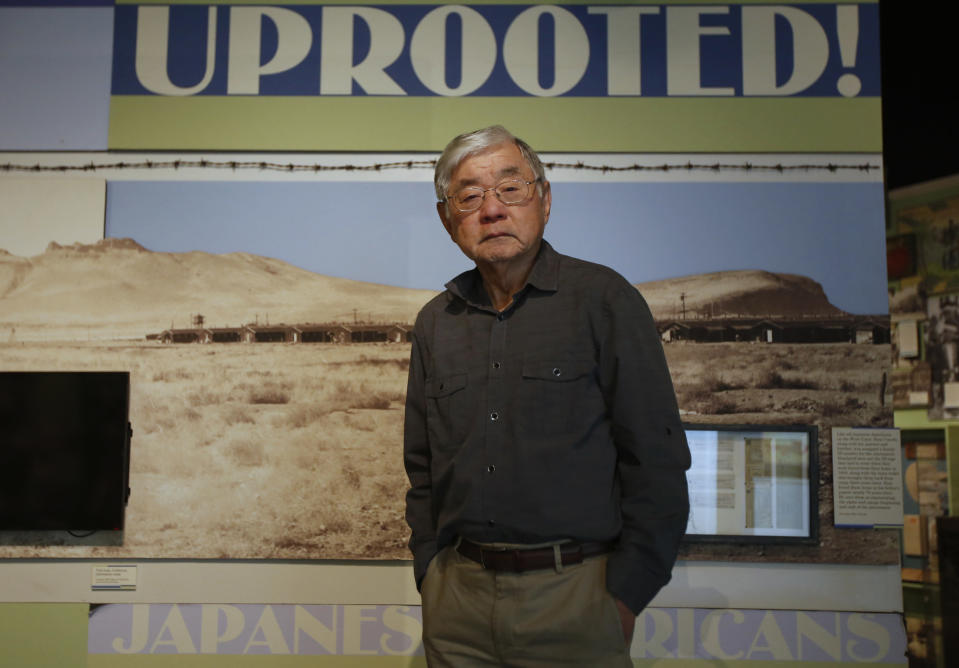 "In this photo taken Tuesday, Feb. 11, 2020, Les Ouchida poses at the permanent exhibit titled ""UpRooted Japanese Americans in World War II"" at the California Museum in Sacramento, Calif. Ochida, who is a docent for the exhibit, was a child when his family was forced to move in 1942 from their home near Sacramento to an internment camp in Arkansas. Assemblyman Al Muratsuchi, D-Torrence has introduced a resolution to apologize for the state's role in carrying out the federal government's internment of Japanese-Americans. A similar resolution will be brought up before the state Senate by Sen. Richard Pan, D-Sacramento. (AP Photo/Rich Pedroncelli)"