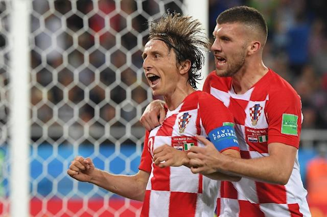 Croatia's midfielder Luka Modric (L) celebrates scoring a penalty with his teammate forward Ante Rebic during the Russia 2018 World Cup Group D football match at the Kaliningrad Stadium in Kaliningrad on June 16, 2018 (AFP Photo/Patrick HERTZOG)