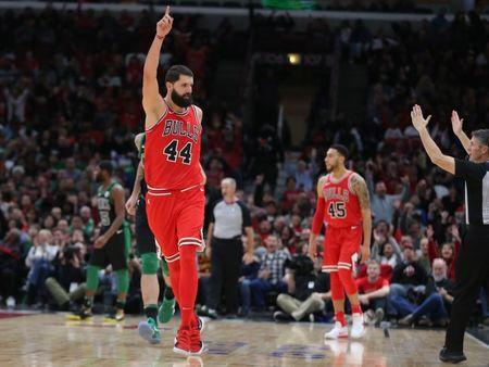 Dec 11, 2017; Chicago, IL, USA; Chicago Bulls forward Nikola Mirotic (44) celebrates after scoring a three point basket during the second half against the Boston Celtics at the United Center. Chicago won 108-85. Mandatory Credit: Dennis Wierzbicki-USA TODAY Sports