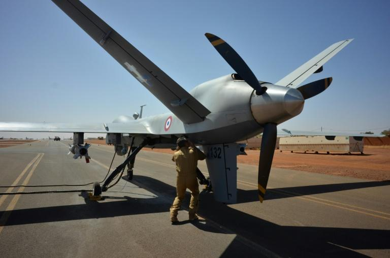 An armed Reaper drone is checked before takeoff at a French base in Niger, part of France's Barkhane anti-jihadist force
