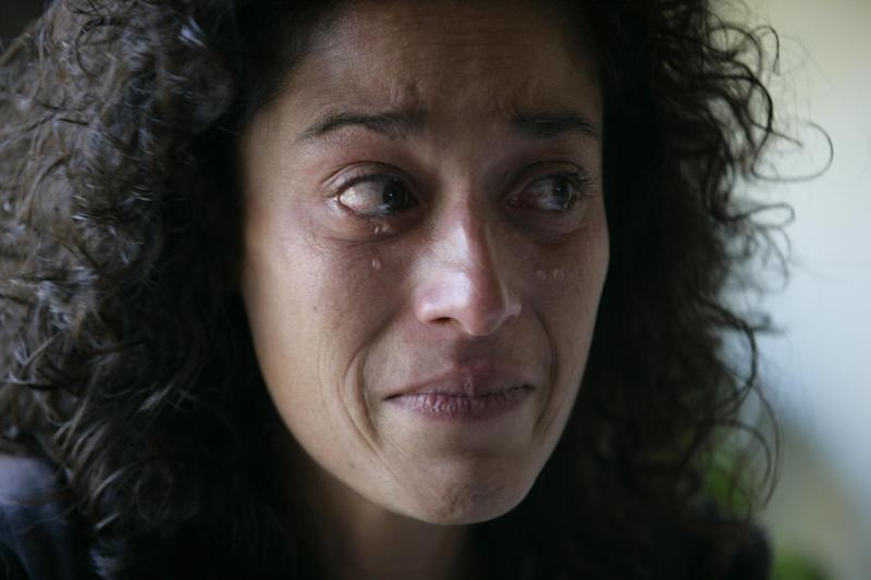 In this Tuesday, Oct. 16, 2012 photo, Andrea Waple cries as she talks about her sister's juvenile life sentence, at her home outside of Columbiaville, Mich. Her older sister, Barbara Hernandez, has been in prison for over two decades after she was sentenced to life without parole. In June 2012, the U.S. Supreme Court delivered a long-awaited ruling, wrestling with questions that have confounded the justice system for years: Should teenagers convicted of the most brutal crimes be punished just like adults? Or should their youth matter? (AP Photo/Al Goldis)