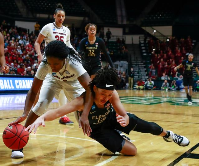 South Carolina guard Doniyah Cliney, left, and Florida State guard Nausla Woolfolk, right, battle for the ball during the first half of a second-round women's college basketball game in the NCAA Tournament in Charlotte, N.C., Sunday, March 24, 2019. (AP Photo/Jason E. Miczek)