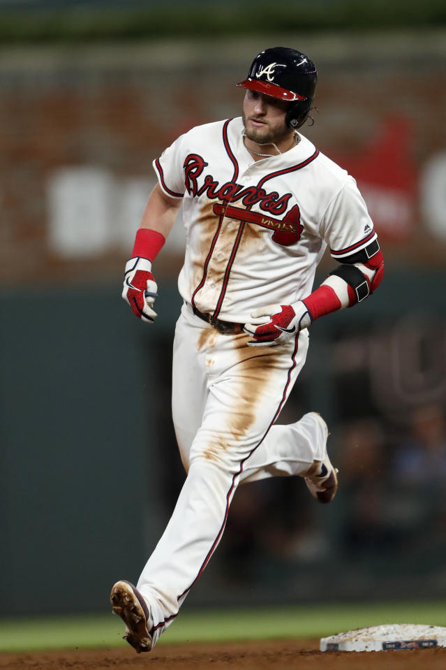 Atlanta Braves' Josh Donaldson rounds the bases after hitting a solo home run in the sixth inning of a baseball game against the Los Angeles Dodgers, Saturday, Aug. 17, 2019, in Atlanta. (AP Photo/John Bazemore)