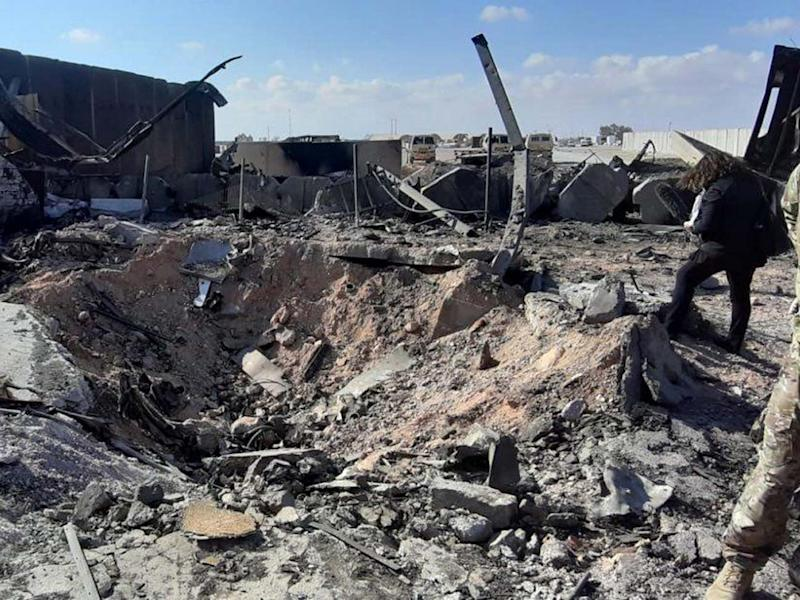 US soldiers stand next the damage that caused by the Iran's missiles attack inside Ain al-Assad air base in Anbar province, Iraq: EPA