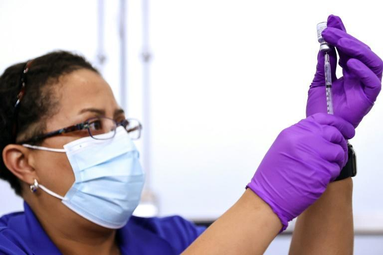 A pharmacist prepares a dose of the Pfizer Covid-19 vaccine at a clinic in New Orleans, Louisiana in August 2021