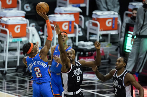 Oklahoma City Thunder guard Shai Gilgeous-Alexander (2) takes a shot against Los Angeles Clippers center Serge Ibaka (9) during the first quarter of an NBA basketball game Sunday, Jan. 24, 2021, in Los Angeles. (AP Photo/Ashley Landis)