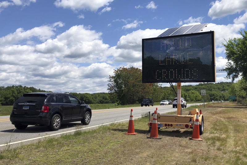 "Drivers on Connecticut Route 2, in Preston, Conn., Monday, June 1, 2020, pass one of four electronic signs erected Sunday night by the state to warn patrons of Foxwoods Resort Casino and Mohegan Sun about the potential dangers of being a large crowd and urging them not to ""gamble with COVID."" Both tribal casinos, closed since March 17, opened despite opposition from Connecticut Gov. Ned Lamont, who has limited power regarding the sovereign nations. (AP Photo/Susan Haigh)"