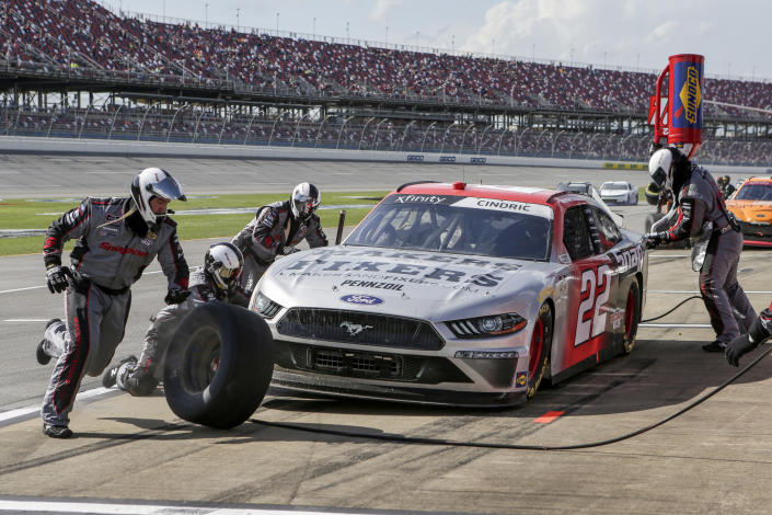 Austin Cindric makes a pit stop during the NASCAR Xfinity Series auto race at Talladega Superspeedway on Saturday, April 24, 2021, in Talladega, Ala. (AP Photo/Butch Dill)