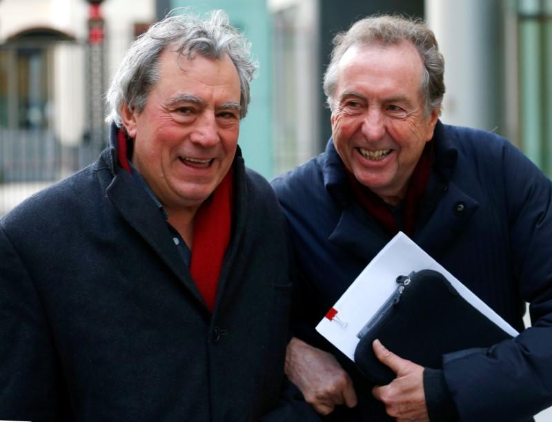 FILE PHOTO: Monty Python members Eric Idle and Terry Jones leave the High Court during a lunch break in central London