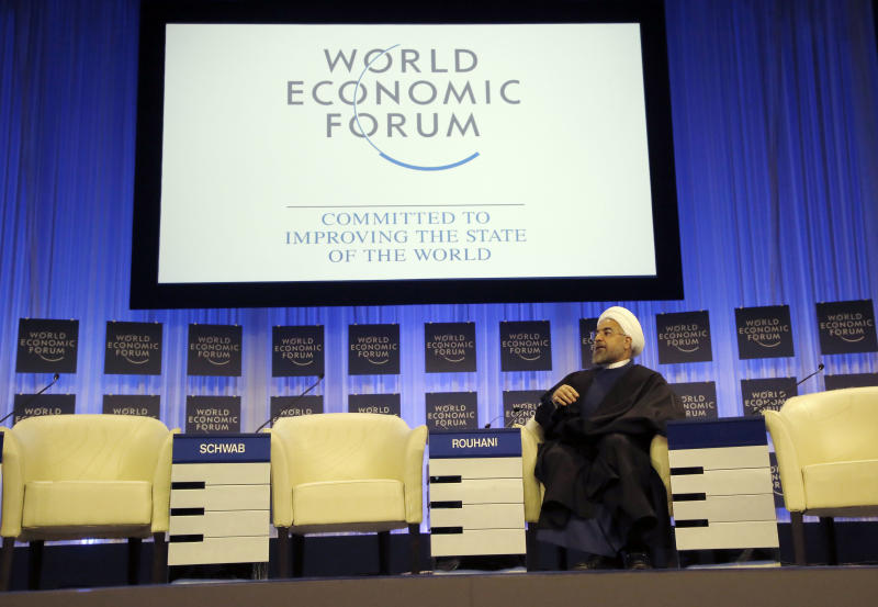 Iranian President Hassan Rouhani is listening to the welcome remarks during a session of the World Economic Forum in Davos, Switzerland, Thursday, Jan. 23, 2014. Leaders gathered in the Swiss ski resort of Davos have made it a top priority to push to reshape the global economy and cut global warming by shifting to cleaner energy sources. (AP Photo/Michel Euler)