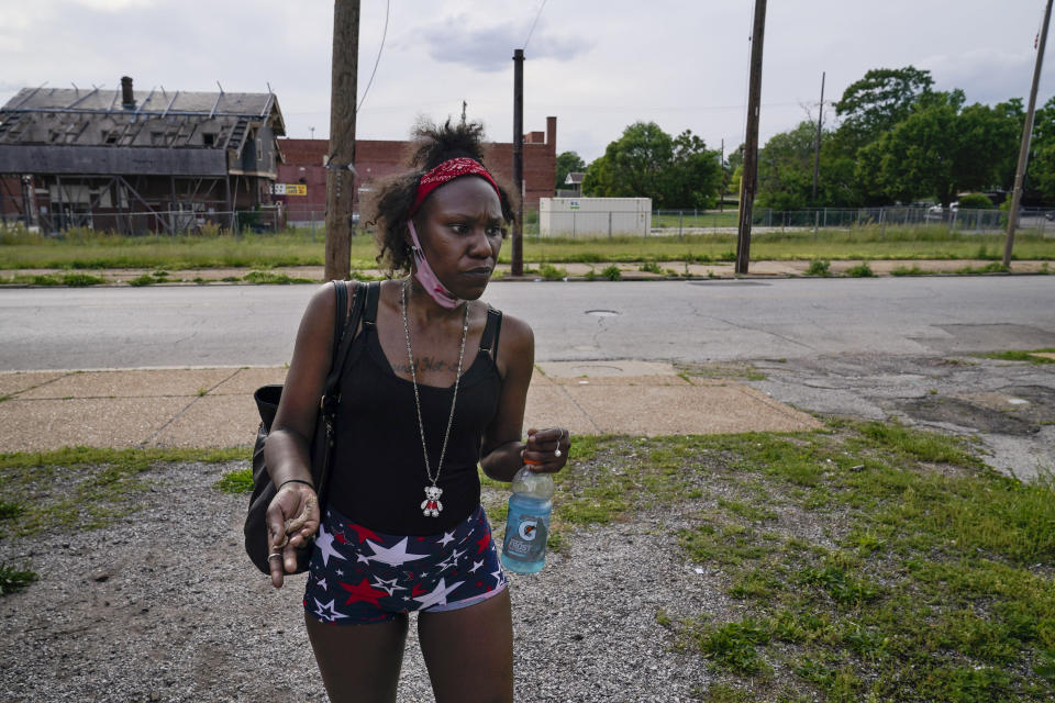 """Jamilia Allen, 31, talks about how she has been beaten down by the streets, raped and assaulted in her effort to make money for drugs, during a visit to a harm reduction mobile unit in St. Louis on Friday, May 21, 2021. """"I'm not going to let this kill me, and if I can help anyone else,"""" she said, """"then that's one less person like me."""" She was once an honor roll student and the captain of her high school cheerleading squad, and back then she judged people desperate for drugs. (AP Photo/Brynn Anderson)"""