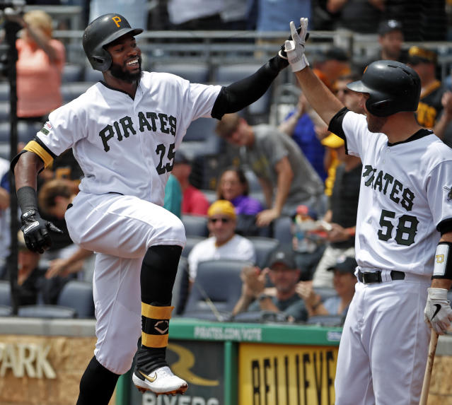 Pittsburgh Pirates' Gregory Polanco (25) celebrates with Jacob Stallings (58) as he returns to the dugout after hitting a solo home run off Atlanta Braves starting pitcher Mike Foltynewicz during the second inning of a baseball game in Pittsburgh, Thursday, June 6, 2019. (AP Photo/Gene J. Puskar)