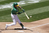 Oakland Athletics' Elvis Andrus hits an RBI-double against the Kansas City Royals during the second inning of a baseball game in Oakland, Calif., Sunday, June 13, 2021. (AP Photo/Jeff Chiu)