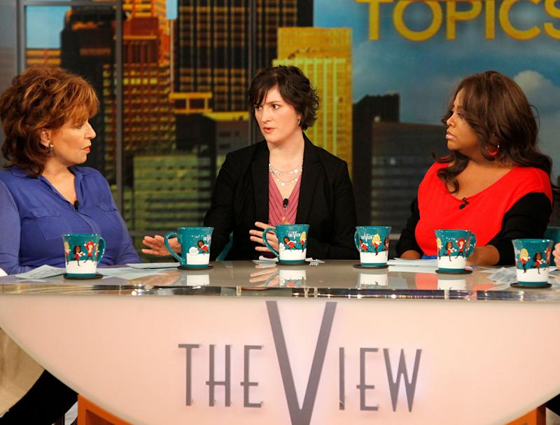 """Georgetown University law student and activist Sandra Fluke, center, speaks as co-hosts Joy Behar, left, and Sherri Shepherd speak during an appearance on the daytime talk show, """"The View,"""" Monday, March 5, 2012 in New York. Fluke talked about conservative radio host Rush Limbaugh and the comments he made on his program after she testified to Democratic members of Congress in support of a requirement that health care companies provide coverage for contraception. Fluke told ABC's """"The View"""" on Monday that she hasn't heard from Limbaugh since he issued a written apology late Saturday. (AP Photo/ABC, Lou Rocco)"""